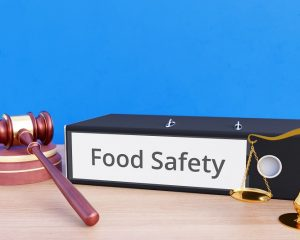 Food Safety – Folder with labeling, gavel and libra – law, judgement, lawyer